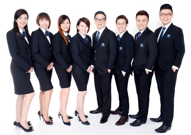 ming property team photo in suits by makeover inc